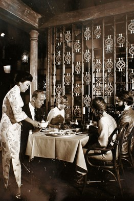 Cecilia Chiang in 1977 serves and explains dishes at her Mandarin restaurant in San Francisco's Ghirardelli Square. (Photo credit Craig Lee / The Wall Street Journal)